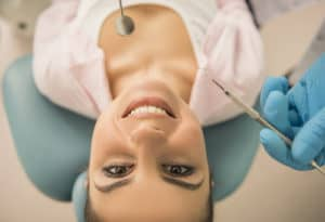 young woman in dental chair looking up